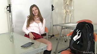 Solo teen model masturbates with toys in a schoolgirl's appliance